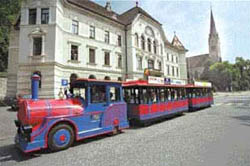 The City-train in front of the Liechtenstein parliment